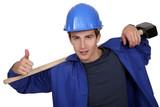portrait of junior carpenter with hammer