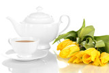 Tea set and tulips isolated on white
