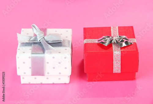 Color gift box with silver ribbon, on color background