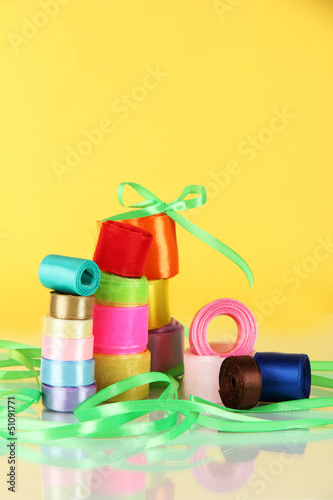 Many bright ribbons of different sizes on light background