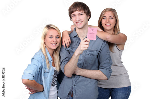 girls and boy holding driving license