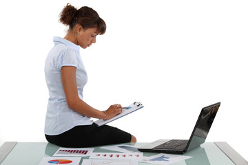 Woman checking financial records
