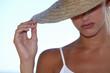 Blond woman wearing straw hat