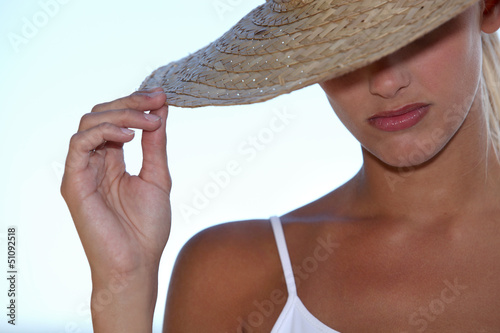 Blond woman wearing straw hat