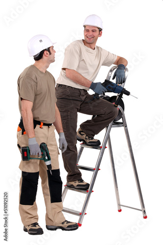 Two handymen at work.