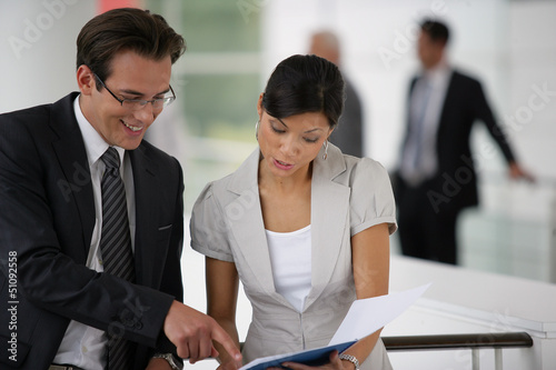 Businesspeople reviewing paperwork