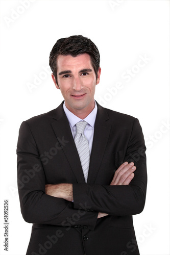 Portrait of a businessman with his arms crossed