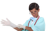 Little boy dressed as surgeon