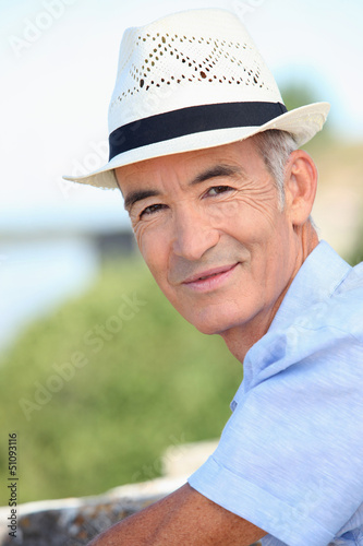 Older man in a straw panama hat