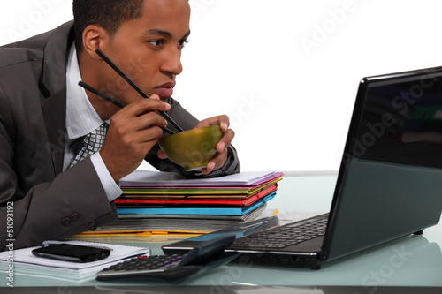 Businessman eating chinese food at his desk