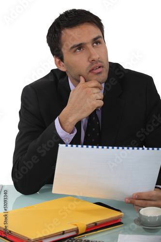 Businessman thinking about a report