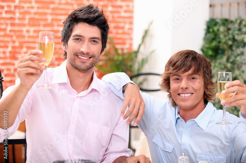 Men drinking champagne in a bar