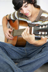 Teen with classical guitar