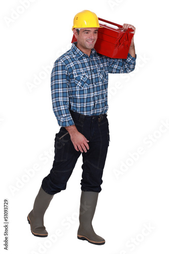 Tradesman carrying his toolbox