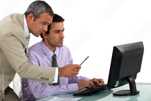 Man giving pointers to his assistant