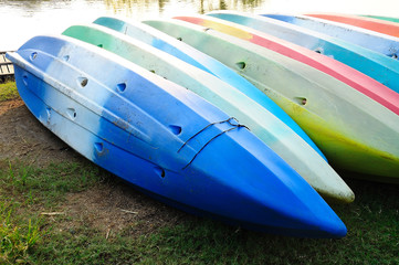 Colorful kayaks in stack
