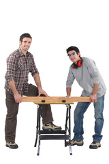 Carpenters working at a bench