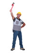 Man proudly raising wrench in the air
