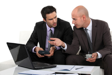 Two businessmen preparing proposal
