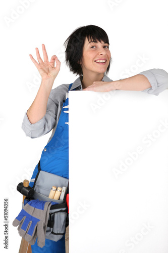 Manual worker with a blank board