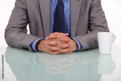 businessman crossing hands