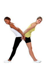 Two women in gym clothing forming the letter X