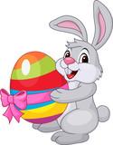 Fototapety Cute rabbit carftoon holding easter egg