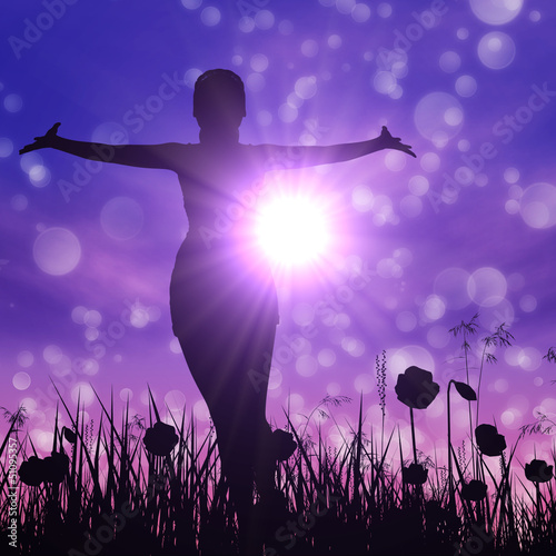 Silhouette of a girl on the meadow