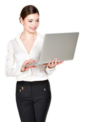 smiling woman holds laptop on hands