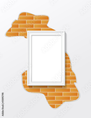 Frame is on the brick wall.