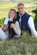 couple drinking wine in their vineyard