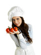 Smiling chef with italian tomatoes