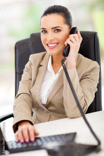 female switchboard operator answering telephone