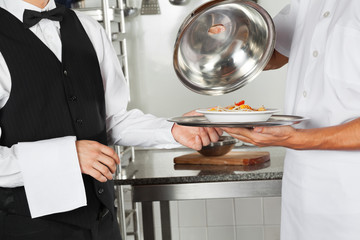 Chef Giving Pasta Dish To Waiter