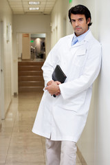 Serious Male Doctor Holding Book