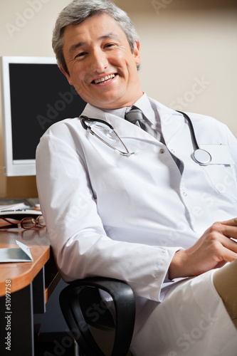 Happy Doctor In Clinic