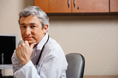 Serious Doctor With Hand On Chin