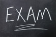 exam sign written with chalk on blackboard