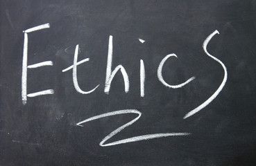 ethics title written with chalk on blackboard