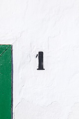 house number one painted on wall
