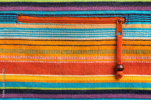 Colorful fabric texture with orange zipper. Mexican style