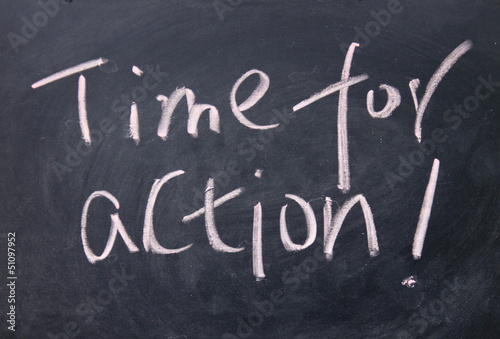 time for action title written with chalk on blackboard