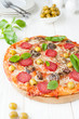 pizza with salami and sliced ​​mushrooms