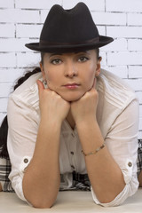 woman in a hat, leaning on the face