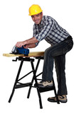 carpenter at work with sander machine isolated on white poster