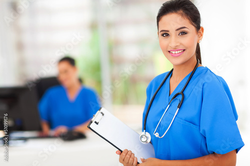 intern nurse holding a clipboard