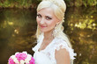 Happy smiling bride with bouquet of flowers, Outdoors portrait