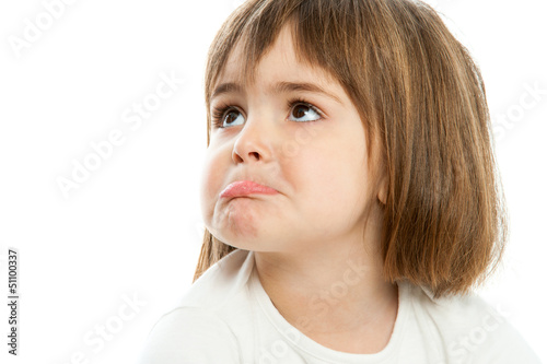 Small girl pulling up lips.