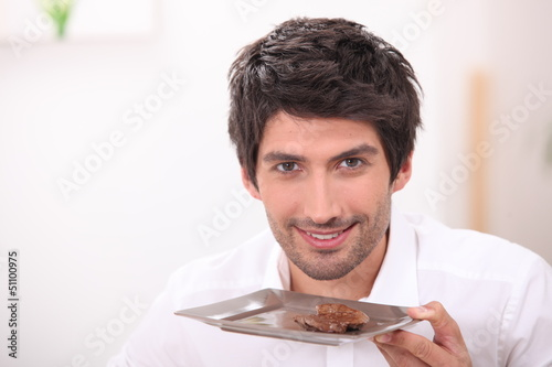 Man with a plate of steak