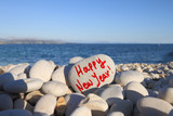 2014  new year written on heart shaped stone with spray brush